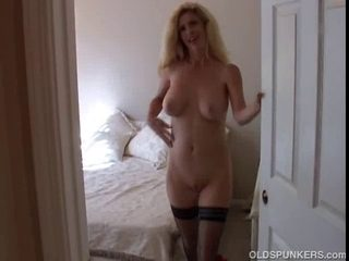 Blond mother I'd like to fuck in nylons shows off her enchanting large boobs and
