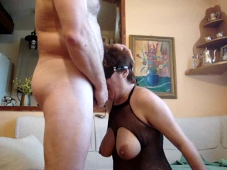 Mature slave girl on her knees deepthroating cock