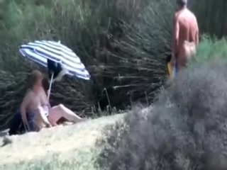 Pervert granny masturbates in front of stranger at beach