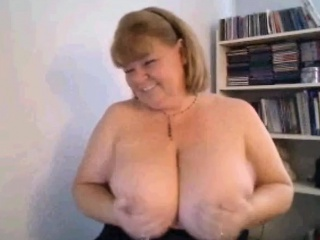 Busty mature woman gets naughty and takes out her huge brea