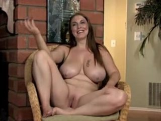 Breasty mature bimbo masturbating