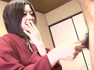 Shy Japanese housewife with a cute smile works her hands on