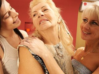 Three elder and young lesbians have fun on the bed