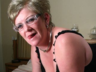 Mature Natalie luvs to moisten on her couch