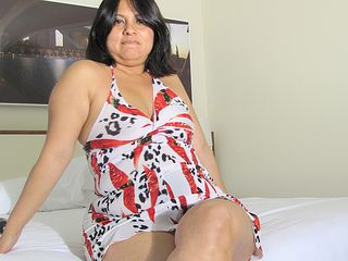 Kinky housewife getting wet on her bed
