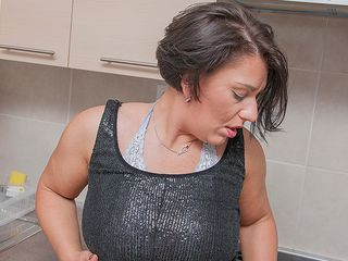 Luxurious mother peels off off her clothes and feels herself up
