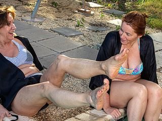 2 mature friends get their all girl groove on at the pool