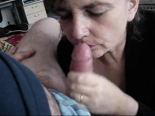 Adult woman on her legs stroking on his penis
