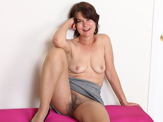 Hairy mature bi-atch toying with her cootchie