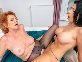 Grandma and huge-chested young nymph munch each other's vags