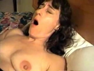hubby fistfucks his wife, she is rubbing her pussy