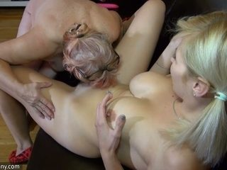 Busty and hot blonde girl is undressed and seduced by granny