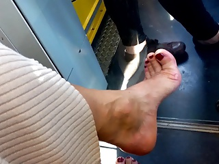 naked mature feet in high heel position