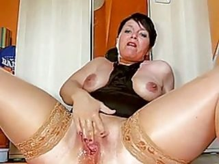 Dirty talking German mature squirting on cam