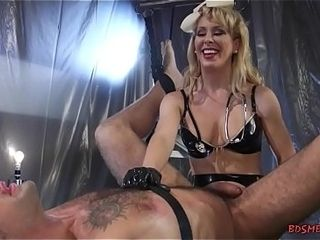 Sexy light-haired domina pegging her gimp