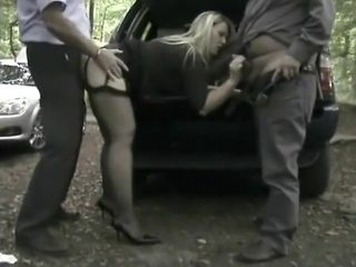 Golden-Haired wench receives screwed by 2 chaps outside.