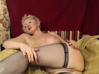 Big breasted blonde amateur in black stockings gives it all