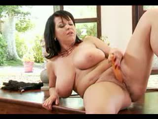 Big breasted mature whore plays with tits and a dildo