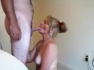 Hawt older on her knees engulfing his cum out