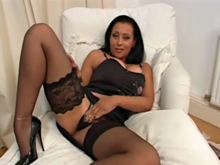 Alluring MILF fondles her twat before toying it