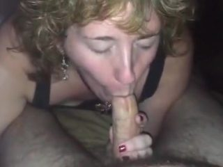 Fucked up bar chick smokes a cigarette, while sucking my dick.