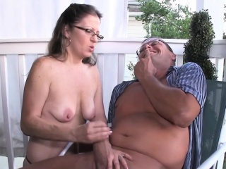 Spex amateur milf giving handjob on the porch