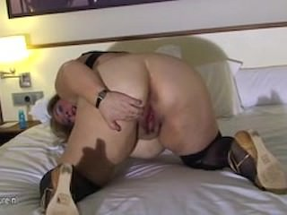 Giant mature wife playing with her vagina on bed