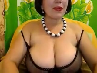 Busty brunette woman fingers her asshole and kneads her big boobs