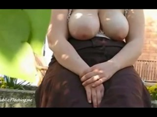 MILF flashes big juggs in the garden