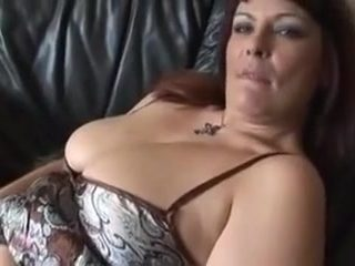 Obese older redhead enjoys playing with her fur pie.