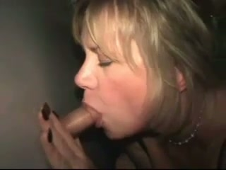 Cheap slutty blonde mature bitch was blowing cock through a glory hole