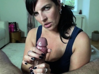 Mesmerizing brunette wife working her skillful hands on a b