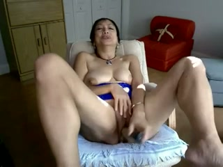 Mature Asian woman with saggy titties toying her pussy