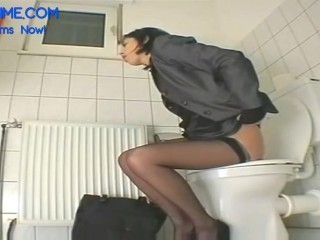 My individual assistant drains with faux-cock at the rest room