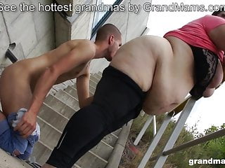Round grannie fellates youthfull dude outdoors