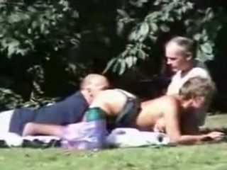 Old and nasty swingers in the park having threesome sex