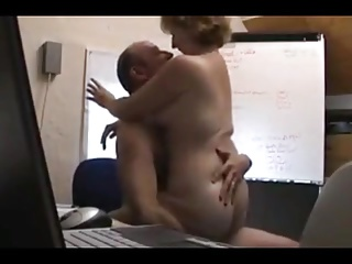 Hidden cam mature slut in office